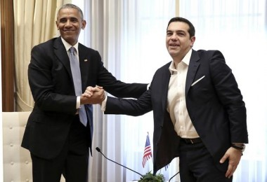 U.S. President Barack Obama, left, shakes hands with the Greek Prime Minister Alexis Tsipras during their meeting at Maximos Mansion in Athens on Tuesday, Nov. 15, 2016. Obama is praising Greece for its financial commitment to NATO — specifically, for being one of five NATO allies that dedicated at least 2 percent of its gross domestic product to defense spending. (Simela Pantzartzi/Pool Photo via EPA)