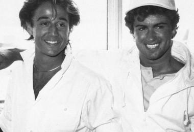 Sporting Caribbean tans, the pop duo Wham!, Andrew Ridgely, left, and George Michael appear at Heathrow Airport, London, after flying in from Miami, May 1, 1984.  (AP Photo/Press Association)