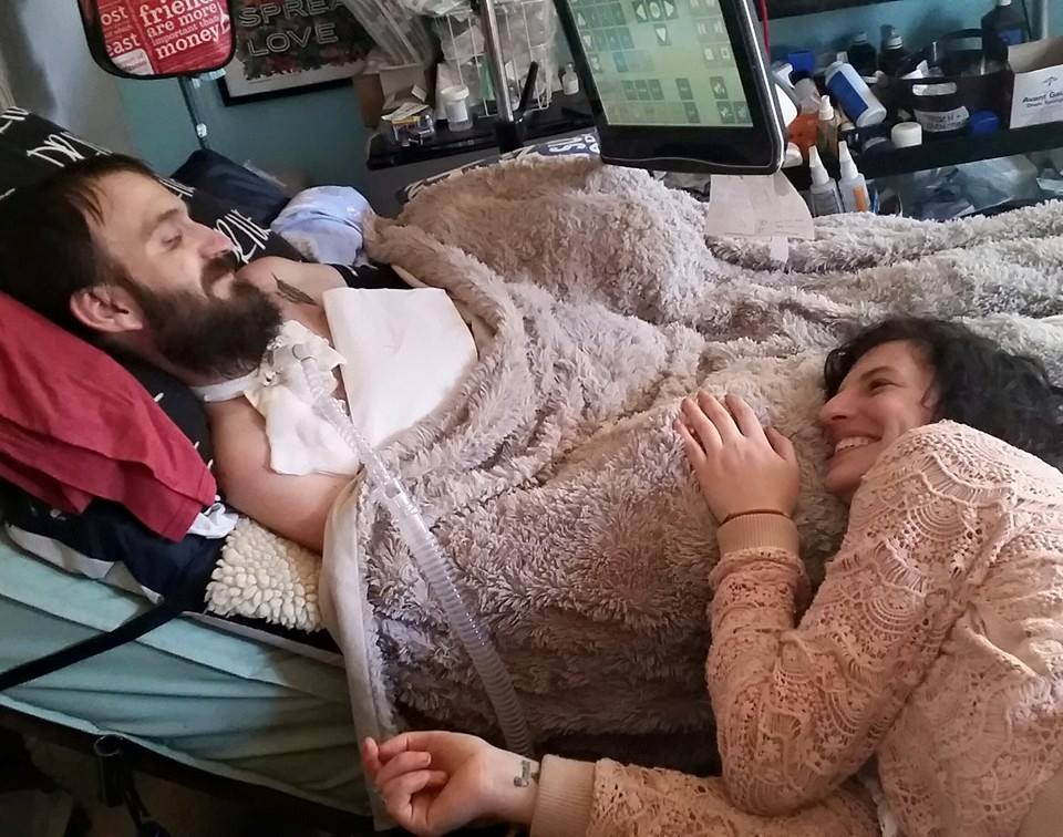 Steve and Hope Dezember with his Tobii eye gaze device at home in March 2015. Courtesy of Hope Dezember