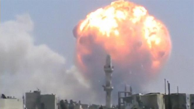 Still image taken from video shows a ball of fire rising after an explosion in the central Syrian city of Homs