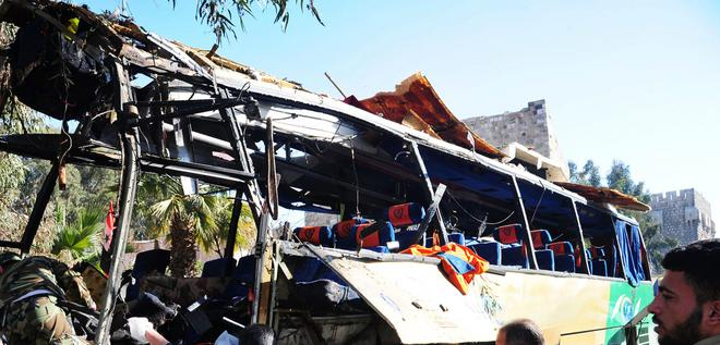 Explosion on bus kills at least six and wounds many more