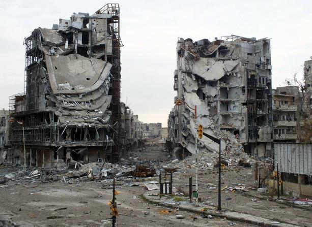 Destroyed buildings are seen on a deserted street in Homs