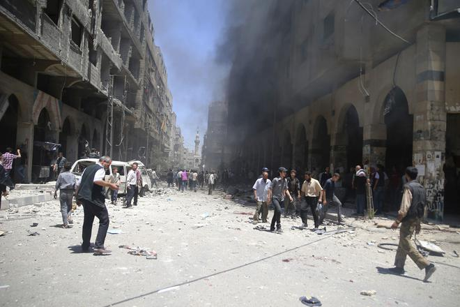 Smoke rises due to what activists claimed was a car bomb explosion in a market in central Duma in the eastern al-Ghouta, near Damascus